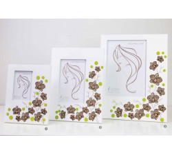 White photo carrier frame with floral decoration